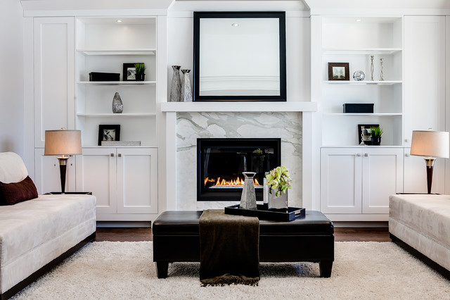 Example of a transitional formal living room design in Toronto with white walls, a standard fireplace and no tv