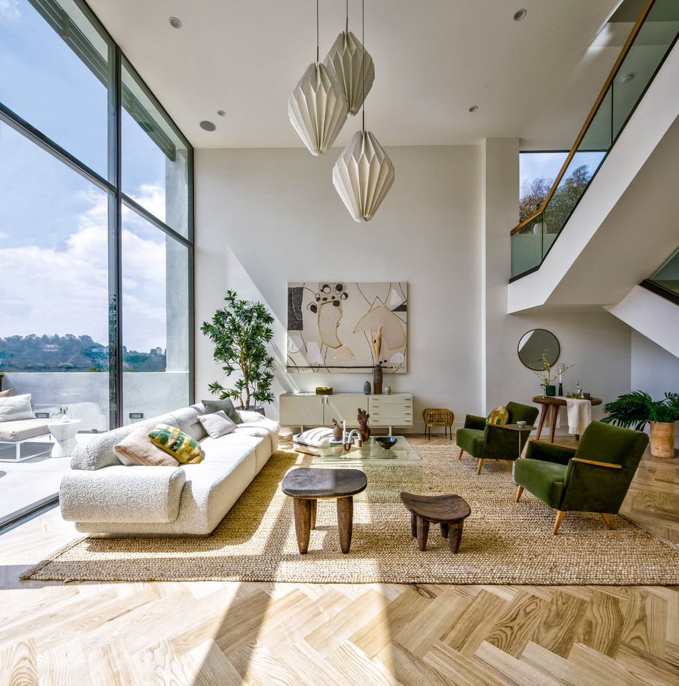 Living room - contemporary open concept light wood floor and beige floor living room idea in Los Angeles with white walls