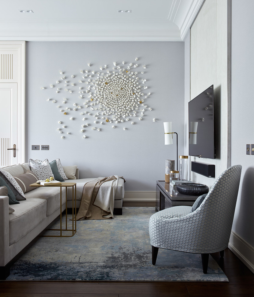 Example of a transitional dark wood floor and brown floor living room design in London with gray walls, no fireplace and a wall-mounted tv