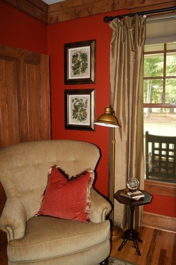 Inspiration for a mid-sized medium tone wood floor living room remodel in Atlanta with red walls