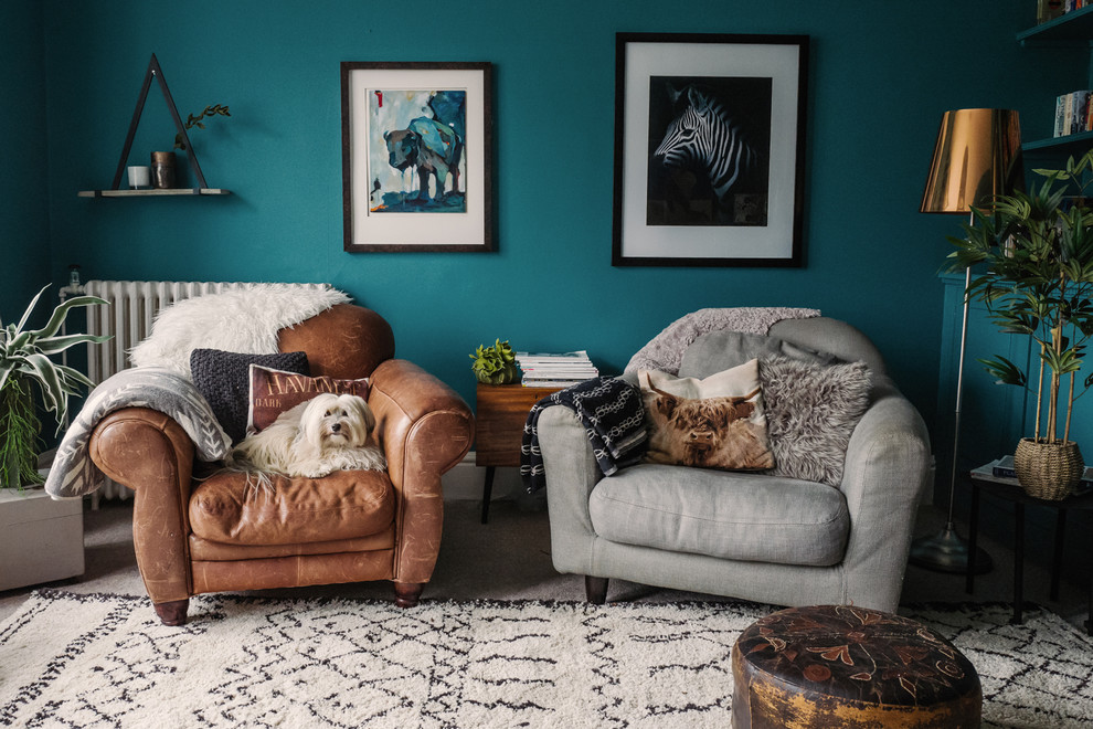Living room - eclectic living room idea in Essex with blue walls