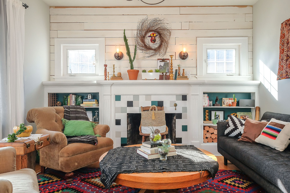 Eclectic light wood floor living room photo in Portland with white walls, a standard fireplace and a tile fireplace