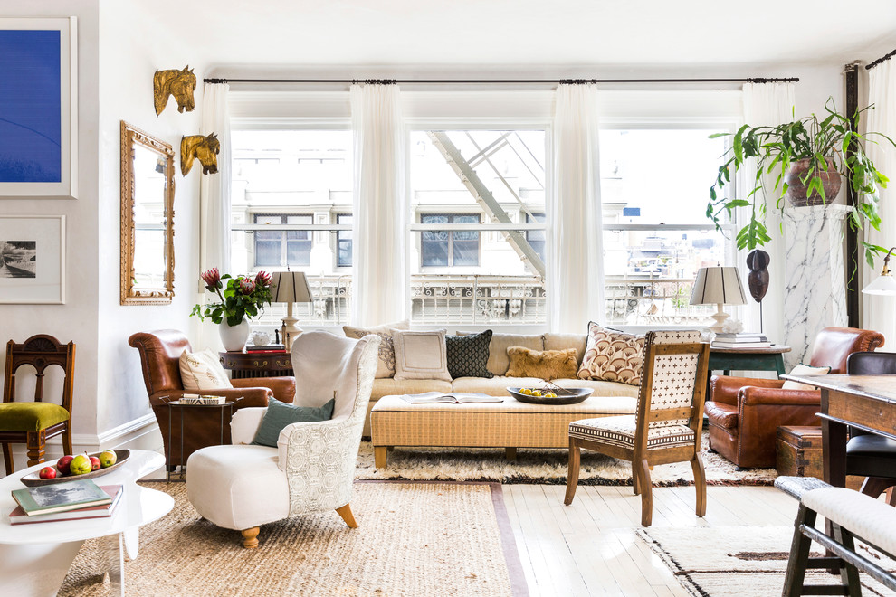 Living room - mid-sized eclectic formal and open concept painted wood floor and beige floor living room idea in New York with white walls, no fireplace and no tv
