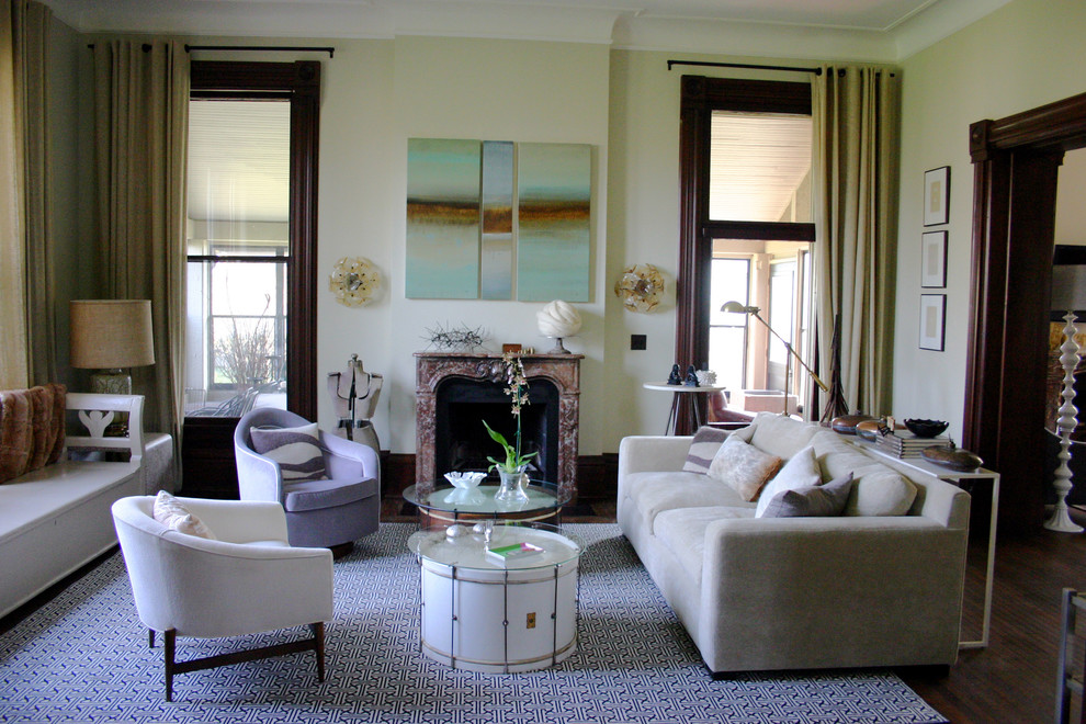 Example of a large eclectic living room design in Chicago with beige walls and a standard fireplace