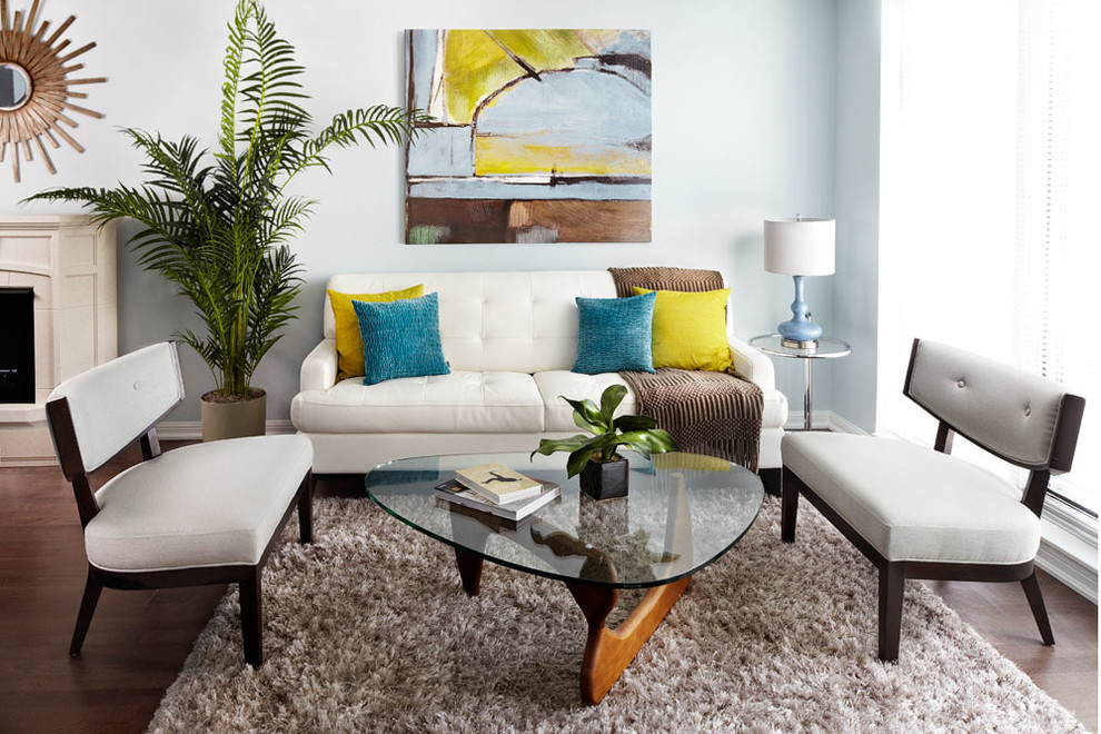 Small eclectic living room photo in Dallas with blue walls