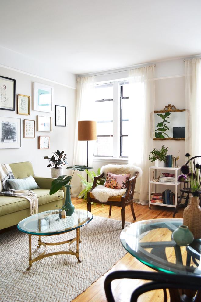 Living room - eclectic medium tone wood floor living room idea in New York with beige walls