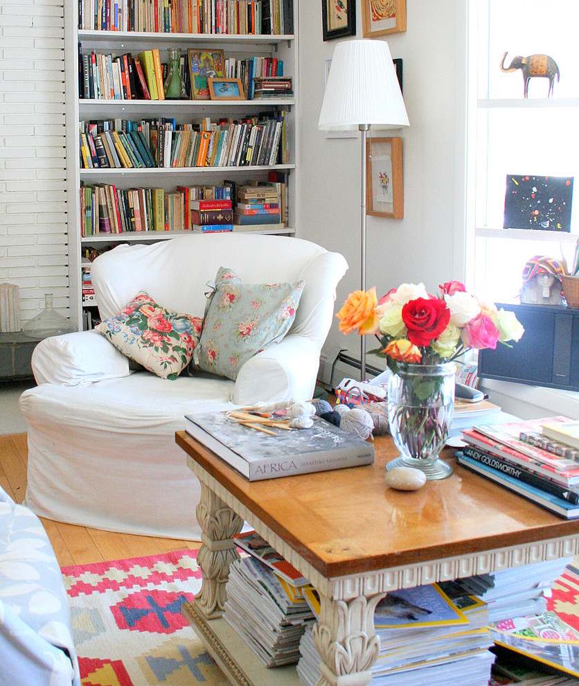 Inspiration for an eclectic living room library remodel in Burlington with white walls
