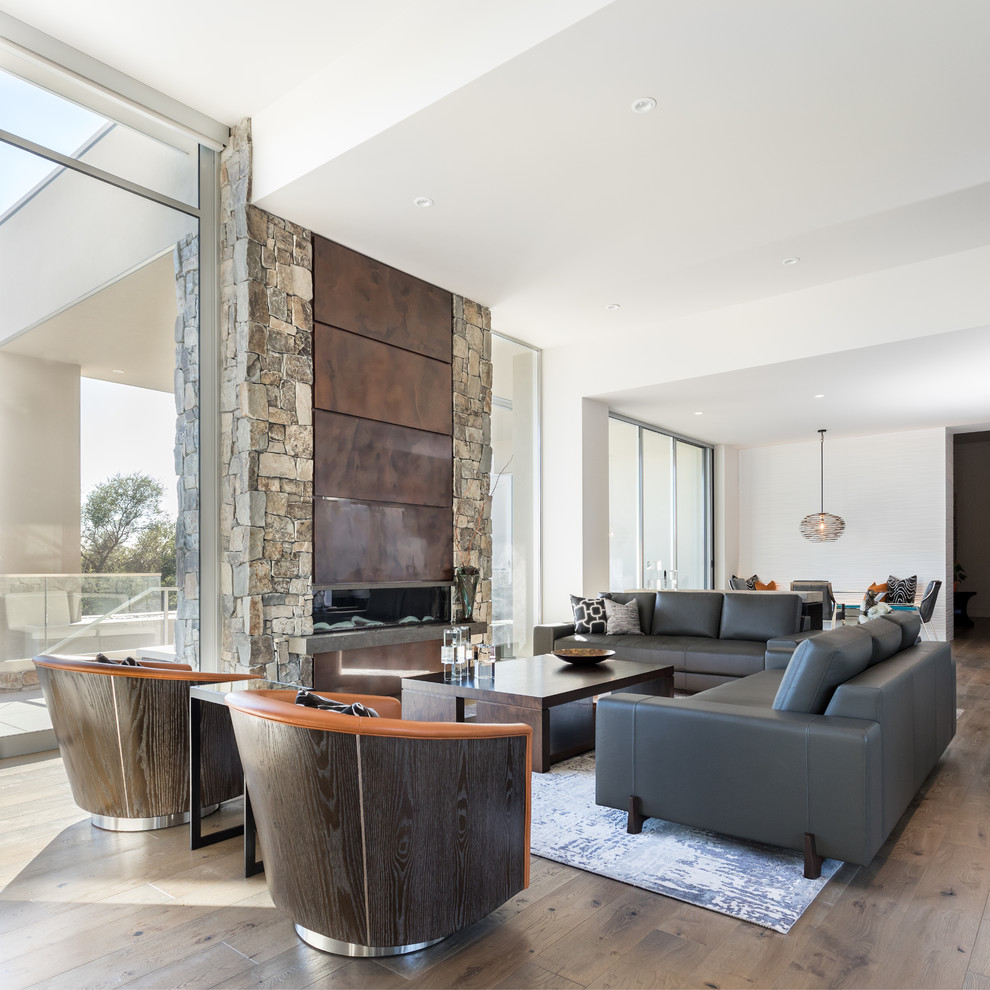 Large trendy formal and open concept medium tone wood floor and brown floor living room photo in Sacramento with white walls, a ribbon fireplace and a metal fireplace