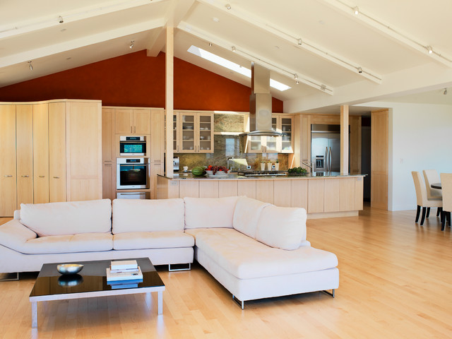Design ideas for a contemporary open plan living room in San Francisco with red walls and light hardwood flooring.