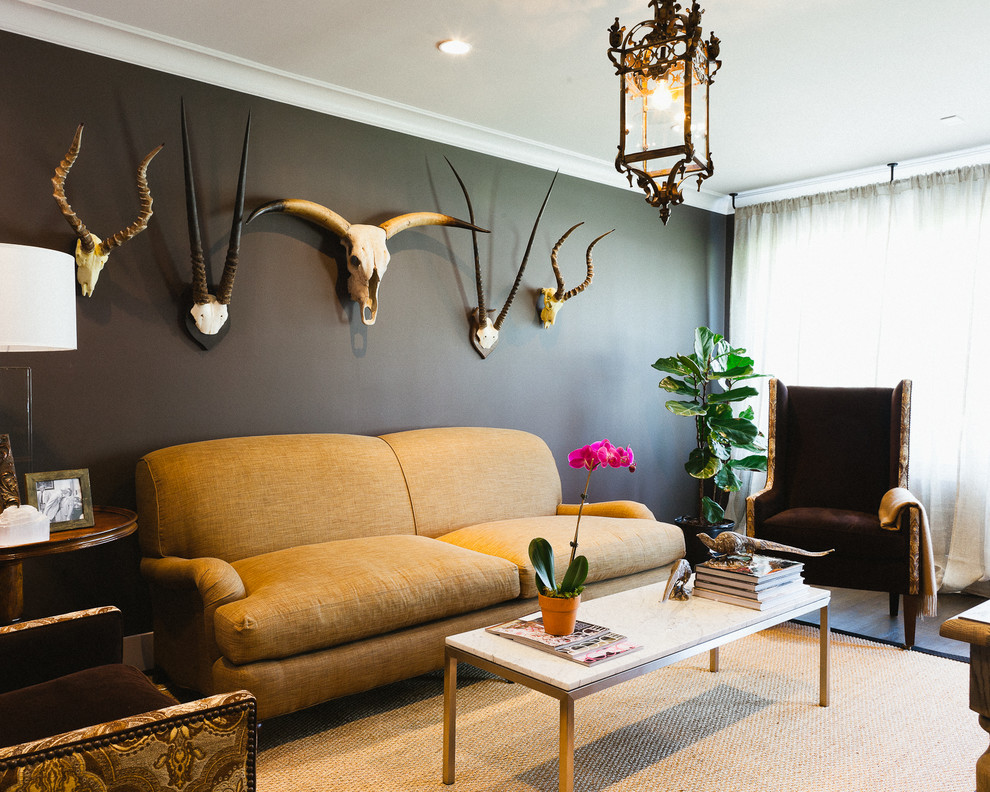 Example of a mid-sized eclectic living room design in Houston with black walls