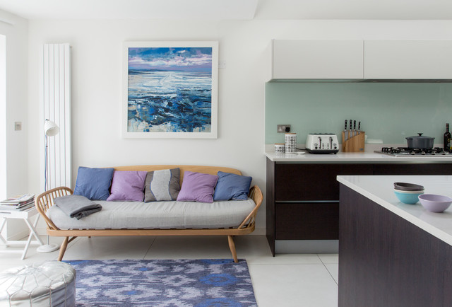 Design ideas for a medium sized contemporary open plan living room in London with white walls and no fireplace.