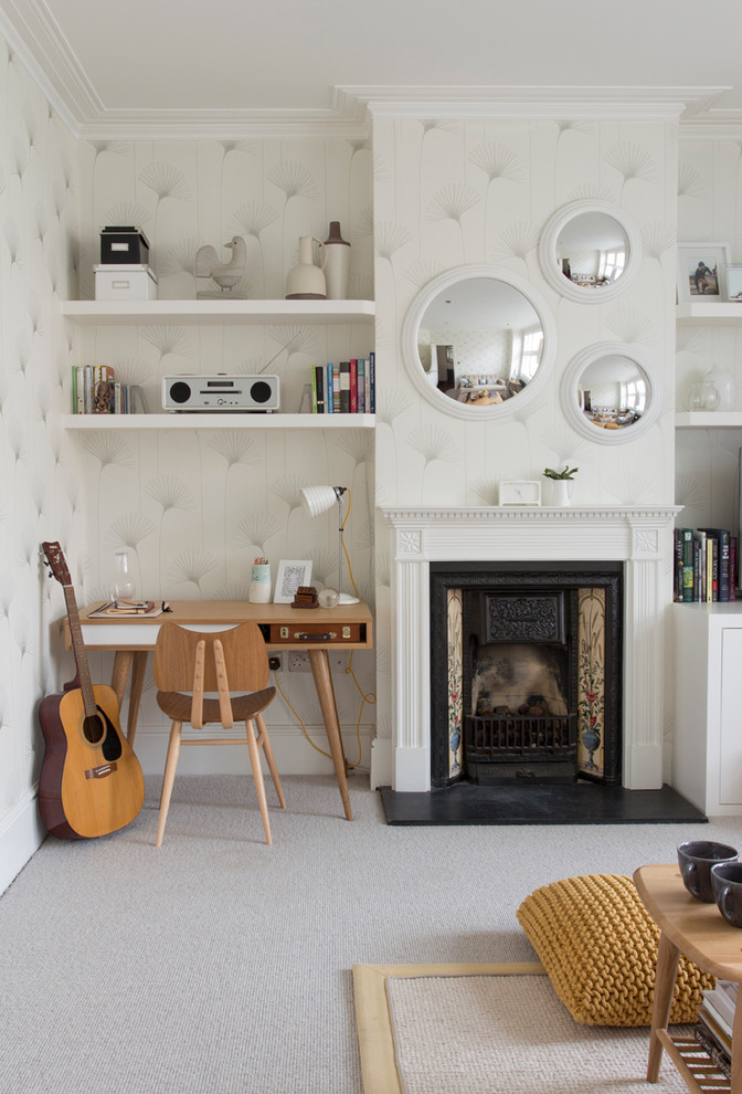 Living room - contemporary carpeted living room idea in London with a music area, beige walls, a standard fireplace and no tv