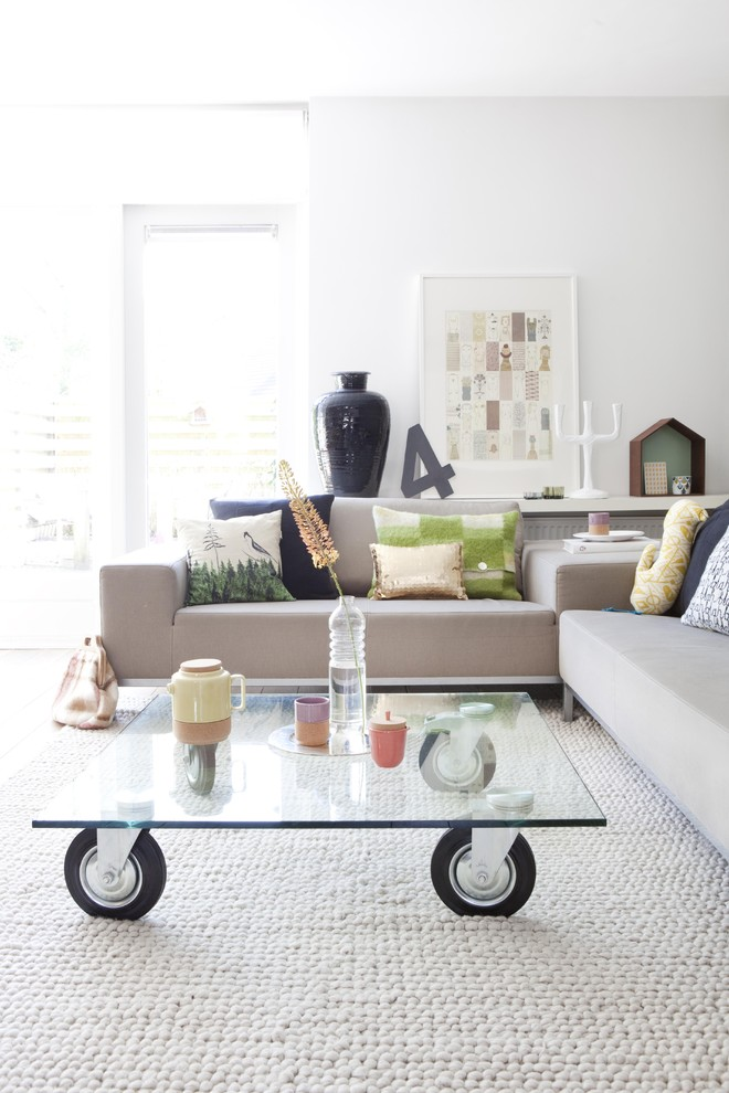 Inspiration for a scandinavian open concept living room remodel in Amsterdam with white walls