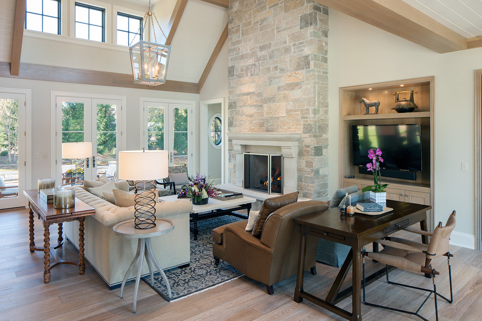 Living room - large transitional open concept and formal light wood floor and brown floor living room idea in Grand Rapids with white walls, a standard fireplace, a stone fireplace and no tv