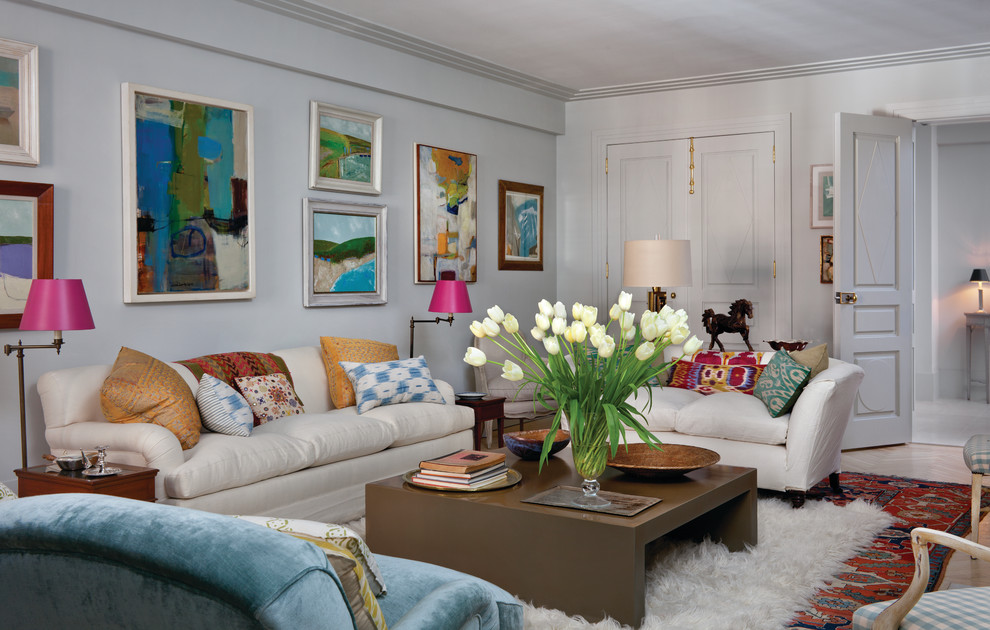 Inspiration for an eclectic enclosed living room remodel in New York with white walls