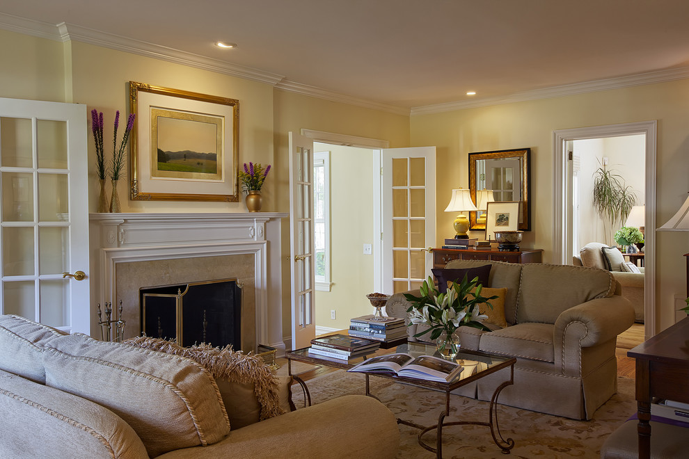 Inspiration for an eclectic living room remodel in New York with yellow walls, a standard fireplace and a stone fireplace