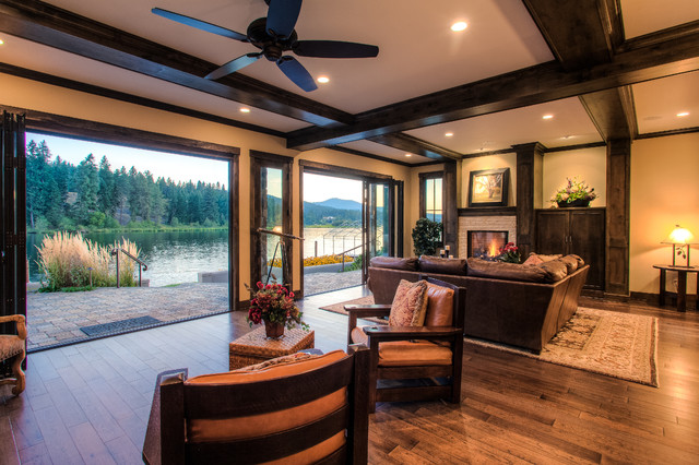Elegant wood beam great room with a waterfront view for Elegant traditional living rooms