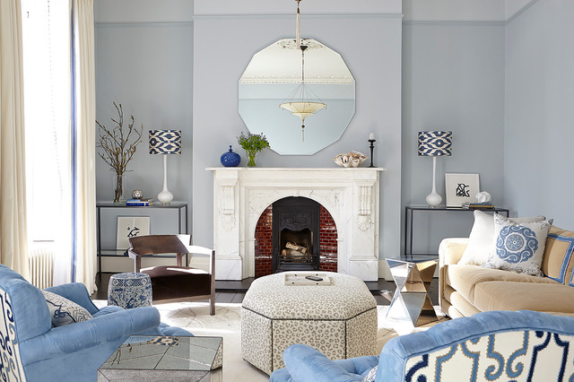 Inspiration for a transitional living room remodel in Dublin with blue walls, a standard fireplace, a brick fireplace and no tv