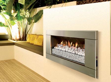 This stunning looking outdoor gas fireplace with a stainless steel Ferro fascia is constructed for immediate huge heat output at the push of a button. The most