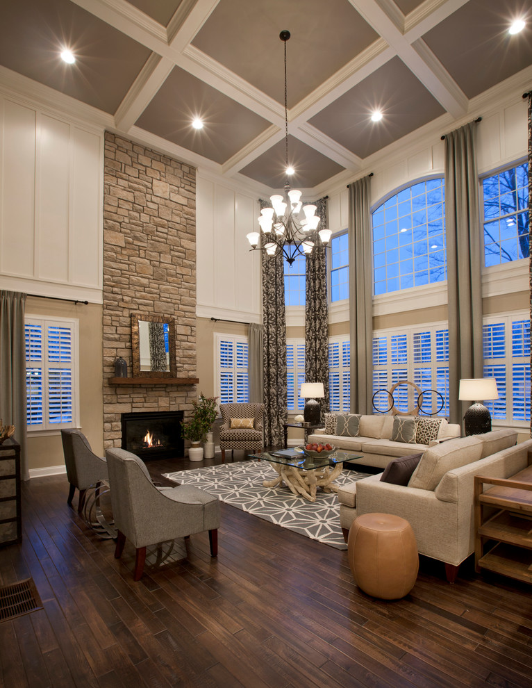 Example of a classic formal and open concept dark wood floor and coffered ceiling living room design in Boston with white walls, a standard fireplace and a stone fireplace