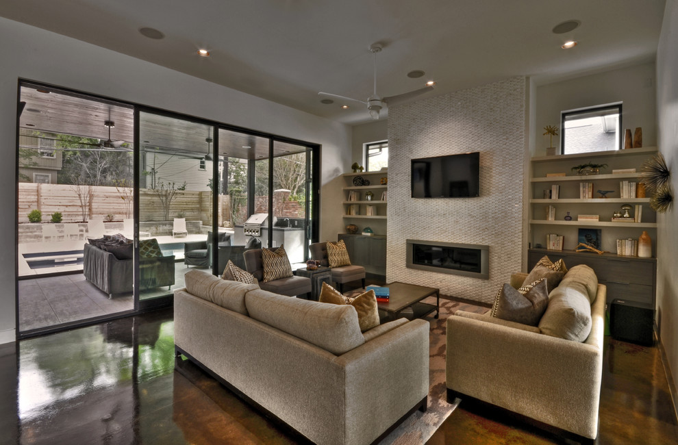 Living room - contemporary concrete floor living room idea in Austin with a tile fireplace
