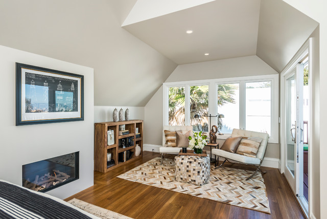 Example of a small transitional open concept medium tone wood floor living room design in San Francisco with a ribbon fireplace and no tv
