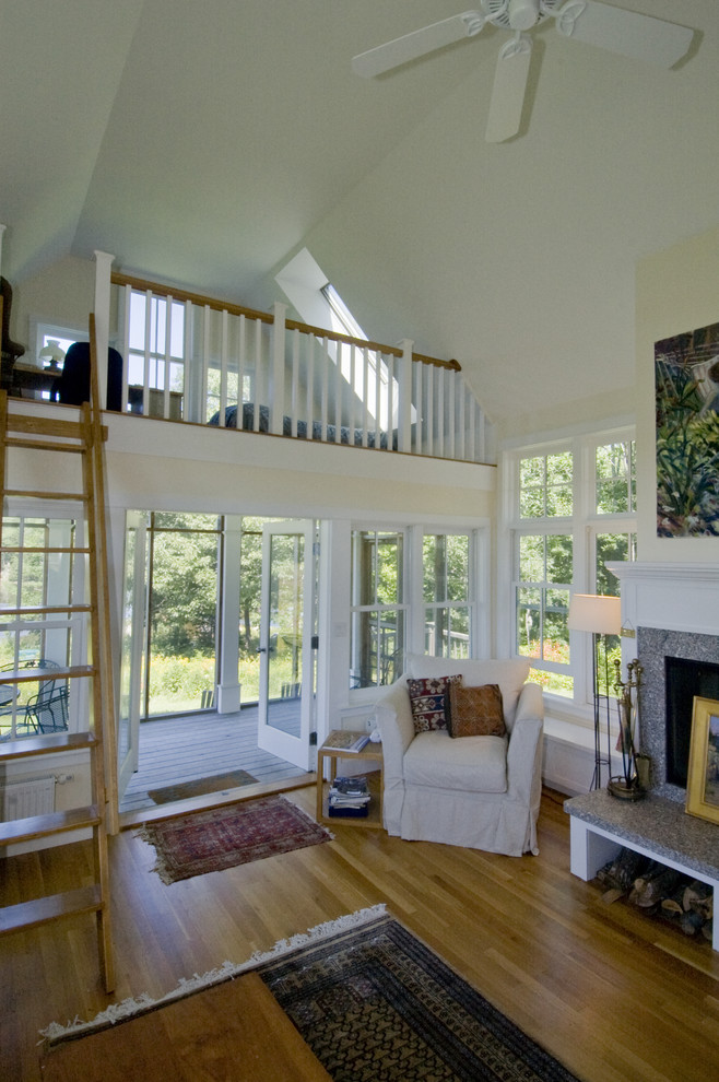 Example of a trendy living room design in Boston with beige walls
