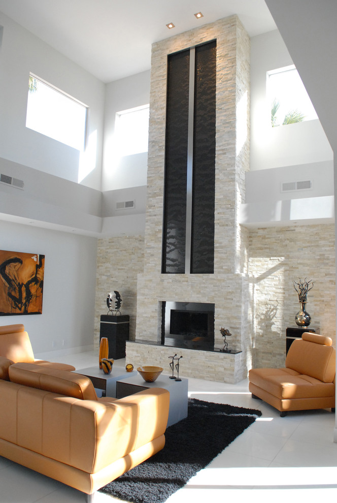 Example of a trendy ceramic tile and white floor living room design in San Francisco with a standard fireplace and a stone fireplace