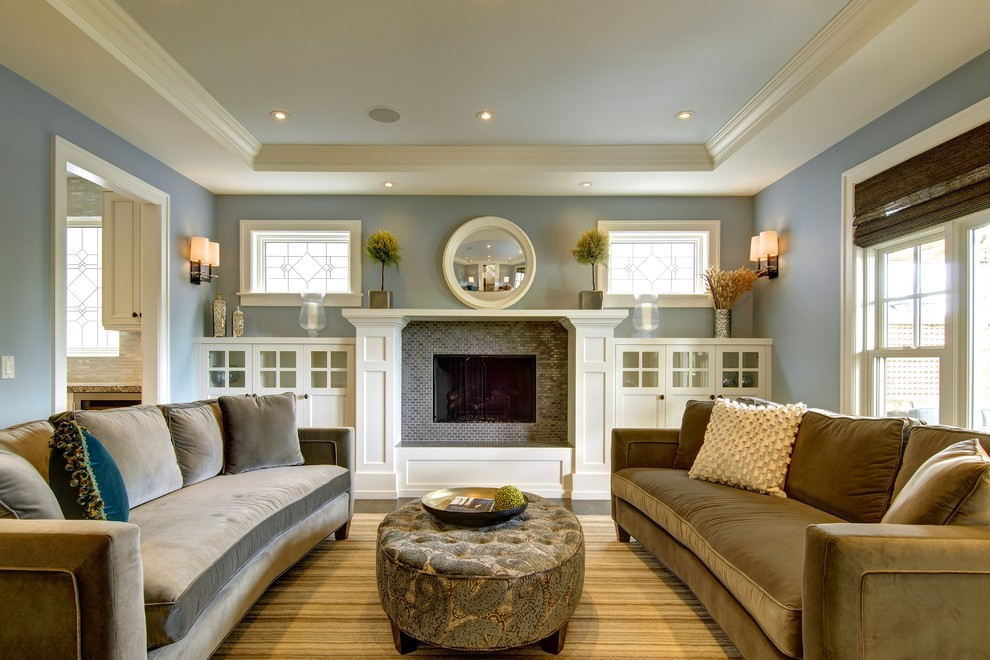 Inspiration for a craftsman enclosed living room remodel in Calgary with blue walls, a standard fireplace, a tile fireplace and no tv