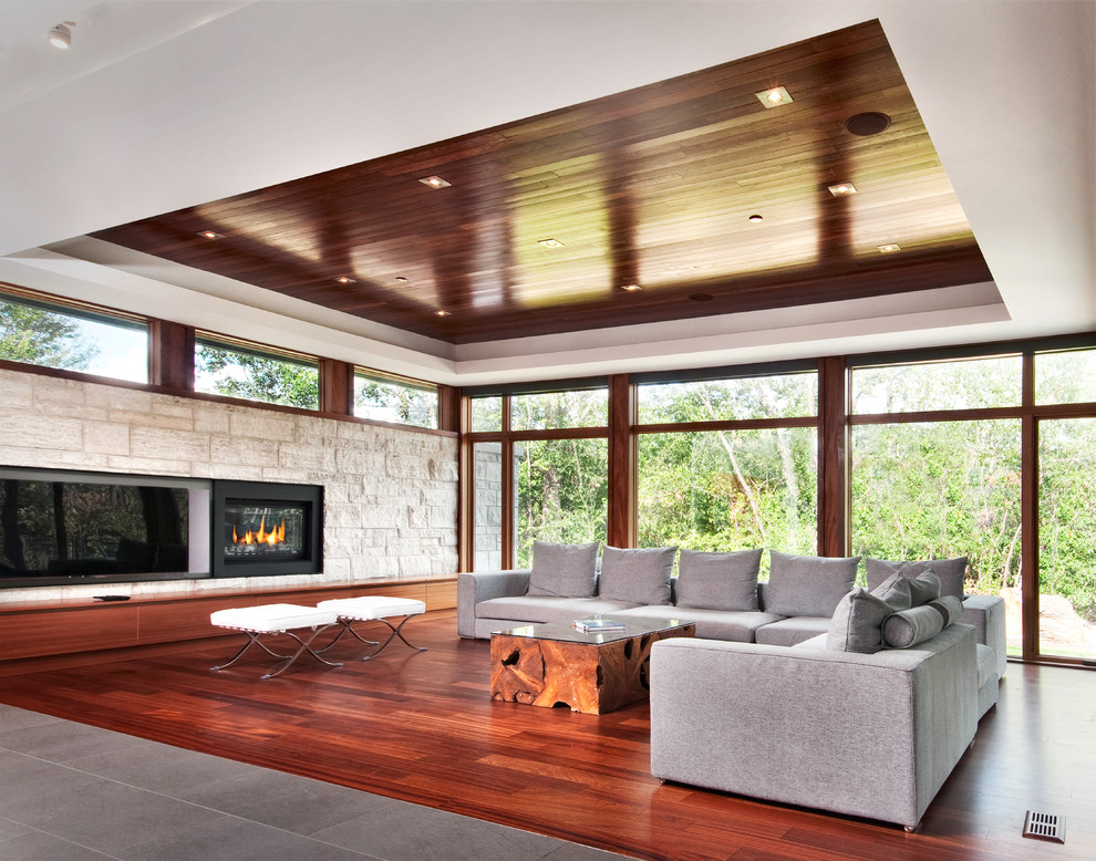 Example of a trendy living room design in Ottawa with a media wall