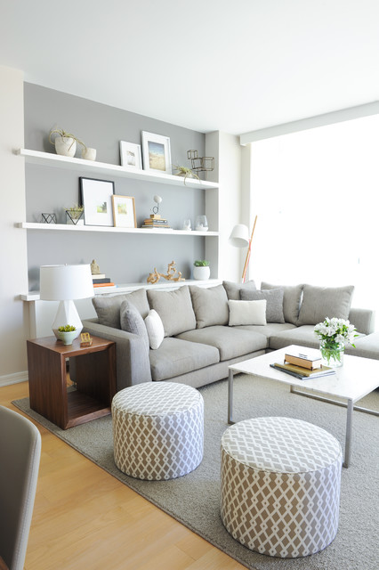 Example of a danish open concept light wood floor living room design in Vancouver with gray walls