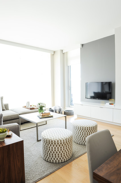 Living room - scandinavian open concept light wood floor living room idea in Vancouver with gray walls and a wall-mounted tv