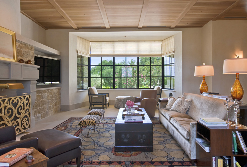 Large trendy formal and enclosed limestone floor living room photo in Austin with beige walls, no fireplace and a tv stand