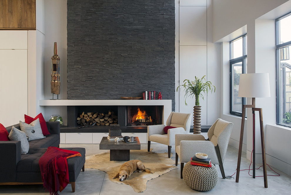 Living room - mid-sized contemporary formal and open concept concrete floor living room idea in Boston with white walls, a standard fireplace and a stone fireplace