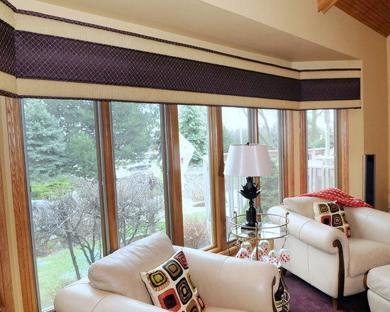 Family Room - Large bay window in family room with an upholstered cornice.  Cornice has contrasting fabrics that coordinate with flooring and furniture.  Fabric adds texture and color to bay window and helps create a warm comfortable feeling in the room
