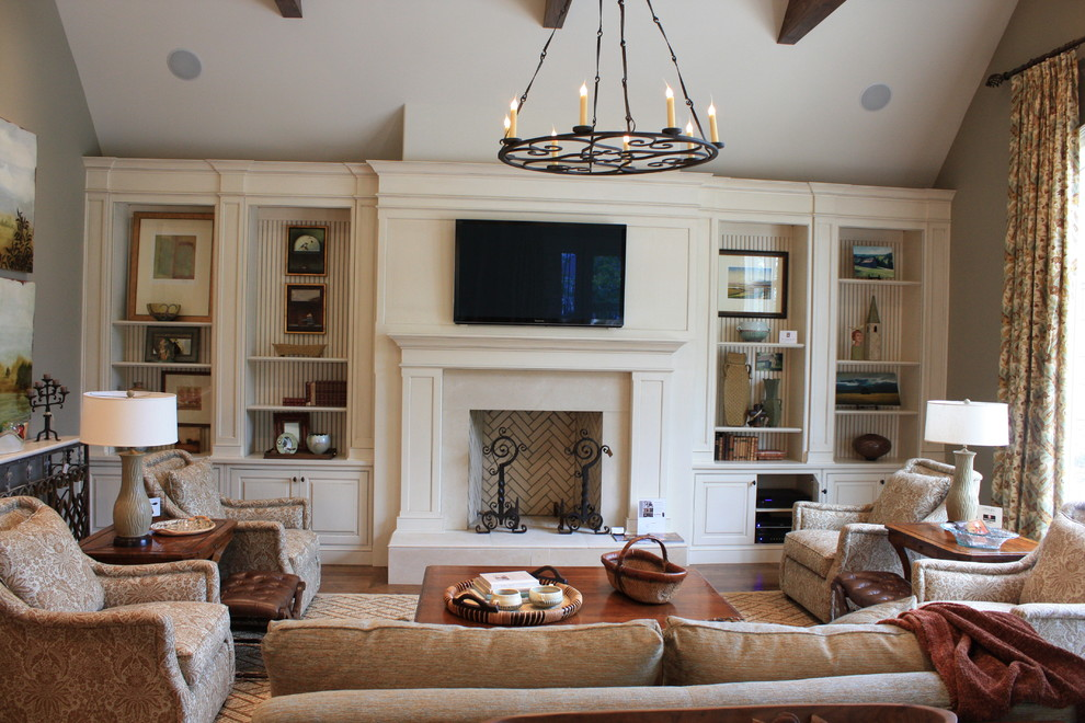 Example of a large classic living room design in Nashville with a standard fireplace and a wall-mounted tv