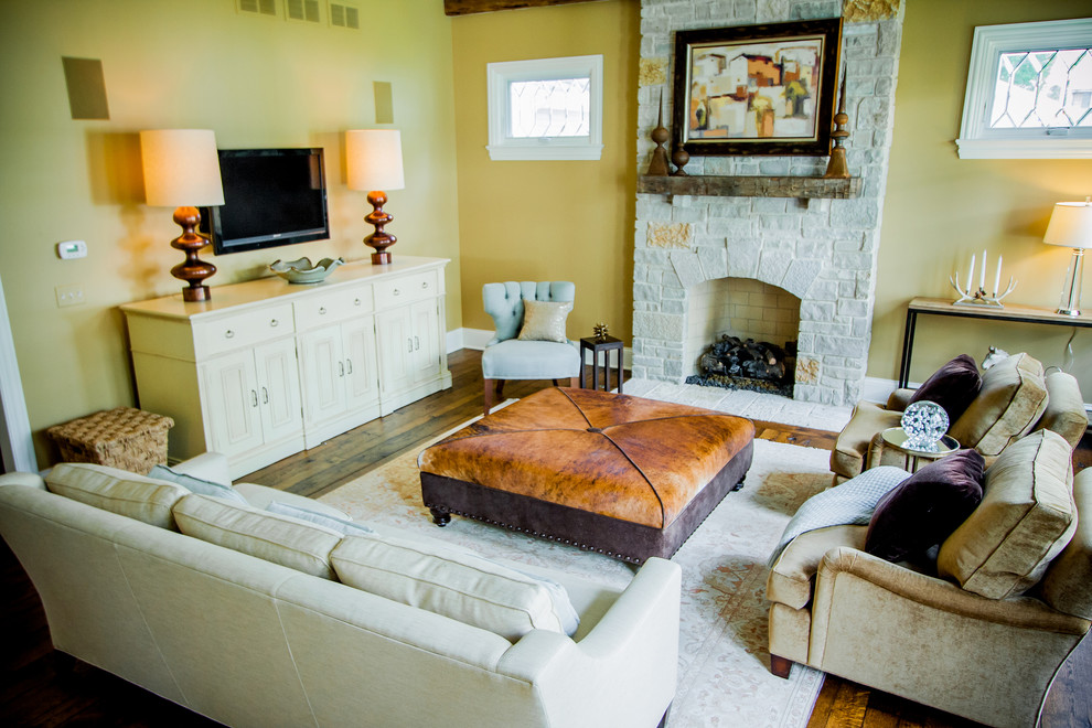 Inspiration for a timeless living room remodel in Chicago with yellow walls, a standard fireplace and no tv