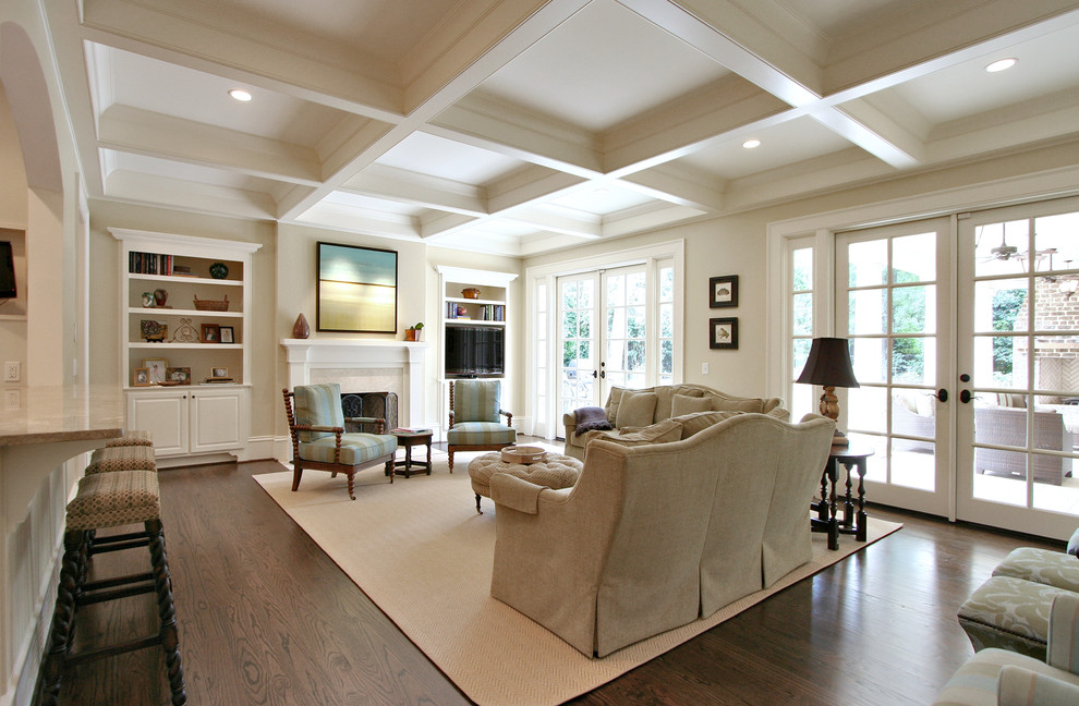Inspiration for a timeless dark wood floor and brown floor living room remodel in Atlanta with beige walls and a standard fireplace