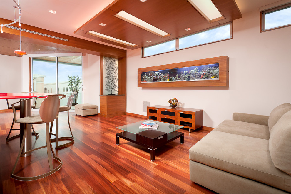 Living room - mid-sized contemporary enclosed medium tone wood floor and red floor living room idea in Los Angeles with white walls