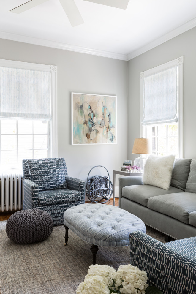 Living room - mid-sized transitional formal and enclosed medium tone wood floor living room idea in DC Metro with gray walls, no fireplace and no tv