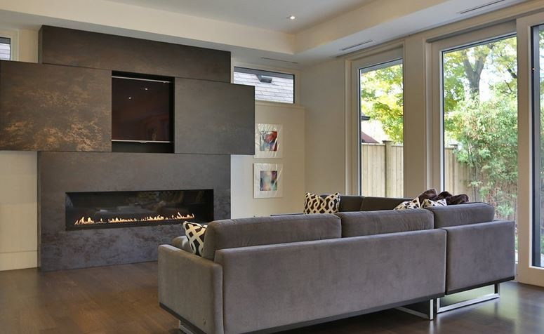 Example of a mid-sized trendy open concept medium tone wood floor living room design in Toronto with white walls, a ribbon fireplace, a tile fireplace and a concealed tv