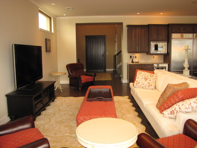 Example of a mid-sized tuscan formal and open concept brown floor living room design in Vancouver with beige walls and a tv stand