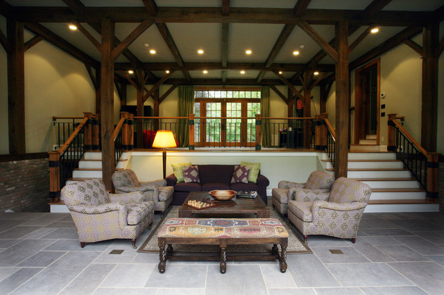 Family room with slate floors, custom hand rails and timber frame. farmhouse-living-room