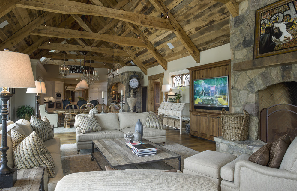 Cottage formal and open concept dark wood floor living room photo in Baltimore with white walls, a standard fireplace, a stone fireplace and a wall-mounted tv