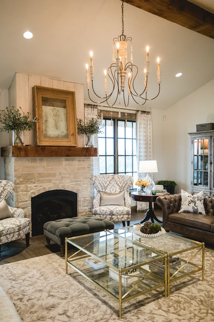 Large cottage open concept medium tone wood floor living room photo in Oklahoma City with white walls, a standard fireplace and a stone fireplace