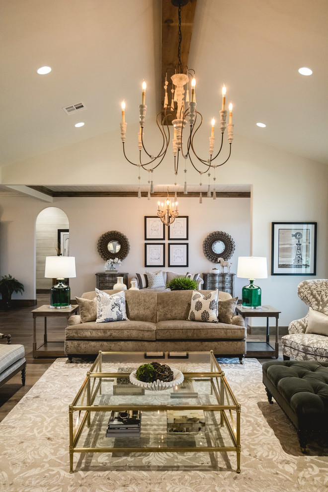 Inspiration for a large farmhouse open concept medium tone wood floor living room remodel in Oklahoma City with white walls, a standard fireplace and a stone fireplace