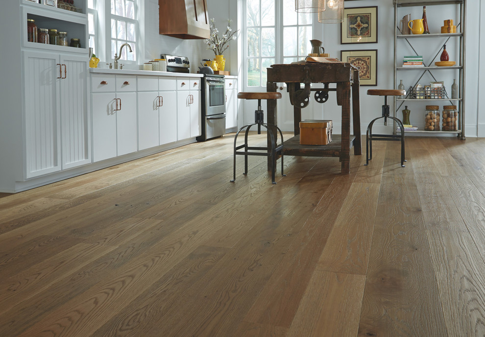 Inspiration for a large country medium tone wood floor living room remodel in Boston