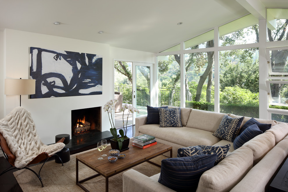 Living room - country black floor living room idea in San Francisco with a standard fireplace and white walls
