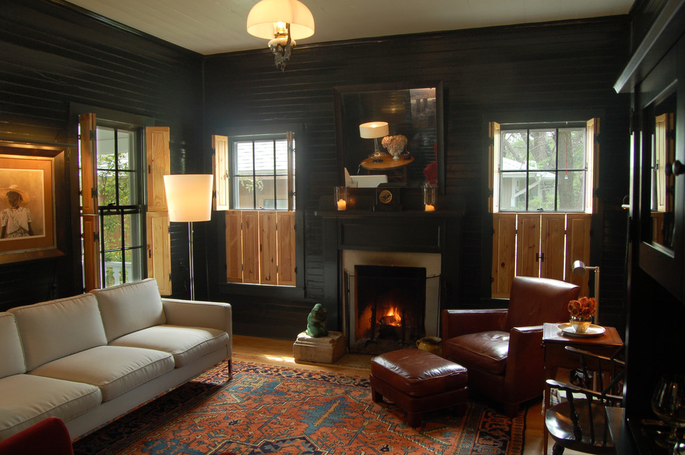 Living room - farmhouse living room idea in Austin with black walls