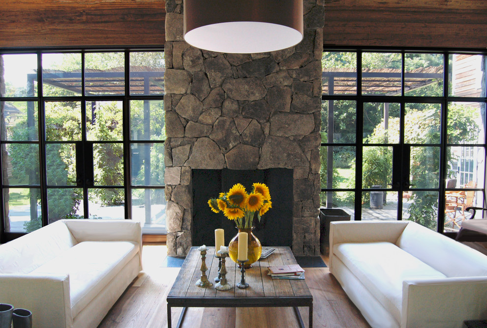 Inspiration for a cottage living room remodel in New York with a stone fireplace and no tv